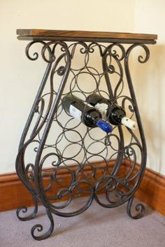 Something like this would be perfect - Antique Style Decorative Metal Framed Wine Rack: Amazon.co.uk: Kitchen & Home