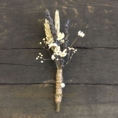"""Wheat and lavender boutonniere. Slight alterations available. Measures 5"""" long. Flowers include: wheat, lavender, starflower and more."""