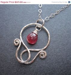 Etsy pendant with ruby