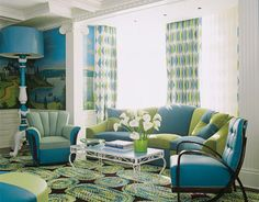 "House Beautiful magazine calls this the ""Grand Manhattan Family Room"" but I just think it's cute. Not too crazy about the furniture styles, but I do like the blue, green & white color scheme. The room has a ""cheerful"" feel to it."