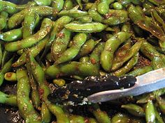 Best Spicy Edamame Recipe - I would recommend steaming the edamame pods rather than boiling.  Boiling pods makes the skin too soft. Pretty spicy may just want to use one serrano or sub jalapeno.