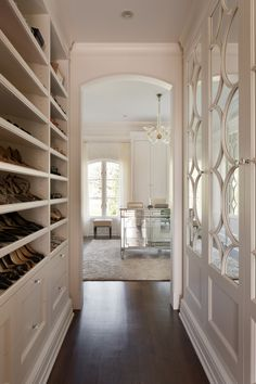 Lovely Walk-In Closet decorating ideas for Killer Closet Traditional design ideas with arched doorway dark wood floor drawers glass drawer pulls glass knob pulls