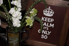 Keep calm its only 50 sign should ease the situation.  See more planning a 50th birthday party ideas at www.one-stop-party-ideas.com
