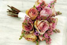 A glamorous wedding bouquet with tones of pink and purple - made by florist Moutan