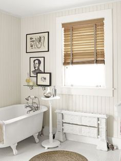 Bright idea: A tall plant stand keeps bath-time necessities within easy reach. #bathroomstorage