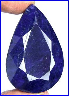 RARE HUGE 195 CT NATURAL BLUE SAPPHIRE FACETED AUTHENTIC GEMSTONE  GEMSTONE : NATURAL SAPPHIRE    TOTAL WEIGHT : 195 CARAT    DIMENSION  :  46 X 32 X 13 MM (Approx.)     ORIGIN : AFRICA    TREATMENT : COLOR ENHANCED    COLOR :   BLUE (AS SHOWN)      SHAPE : PEAR  The card that shows this as being genuine , the certification card will be with it. $17,500 is negotiable