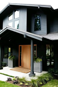 Liking this combination of materials and colours. Dark grey cement ...