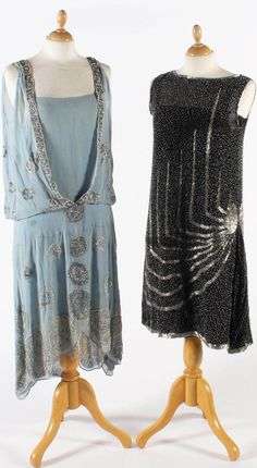 """Left: Pale blue chiffon with beading. Deep V-necked top blousing into dropped waistband. Scalloped hemmed skirt covered in circles & flowers in white- and silver-colored beads, with silver lace underskirt. Right: Black cotton chiffon covered with silver-colored beads and striking design of """"L"""" shapes converging at the hip. Bonham's"""