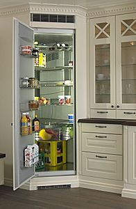 corner fridge and recessed cabinets with drawers