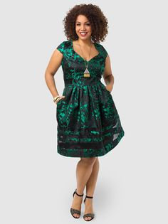 Double V-neck, jacquard-woven dress with pleated skirt and sheer inset detailing at hem. Lined, concealed back zipper. Also comes solid black still with hem detail.