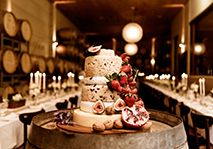 Elegant and rustic! Love how the berries and nuts spill down the side, especially since the wheels of cheese are stacked so tightly together