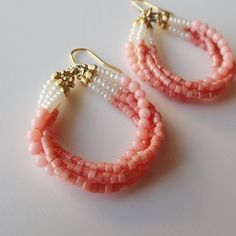 Pink coral and glass beads in a four tiered hook earrings. Slow, feminine curves to the ear lobe. Seed Bead Earrings, Beaded Earrings, Earrings Handmade, Handmade Jewelry, Beaded Bracelets, Unique Jewelry, Pendant Earrings, Diy Bracelets To Sell, Seed Beads