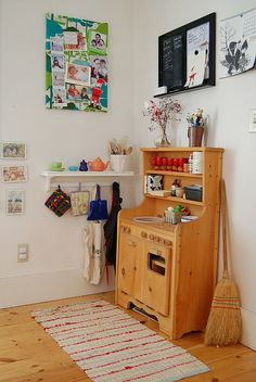 Play kitchen in a common space!  So cute but it will never look this neat if my kids are playing with it!