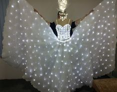 SO GLAM. LED lights sewn into dresses and costumes is so gorgeous, love seeing more and more of this in the fashion industry.