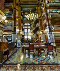The Law Library in the Iowa State Capitol is simply amazing. In addition to the two amazing staircases, there is some great woodwork, a really beautiful stained glass skylight and a tremendous view of Des Moines.