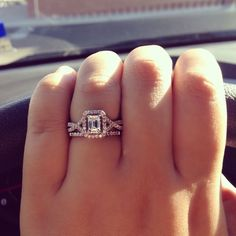 White gold split shank pavé emerald cut halo engagement ring & simple pavé white gold diamond wedding band.