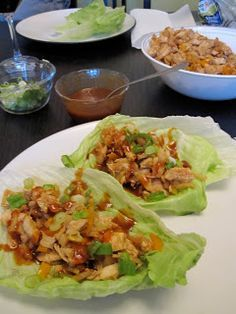 Paleo Girl's Kitchen:   Asian Lettuce Wraps  :::Ingredients::::  2 large Chicken breasts  1 can Water chesnuts  1 can Bamboo Shoots    8 Mushrooms  3 cloves of Garlic  1 Tablespoon Gluten Free Soy Sauce  2 Tablespoons Hoisin Sauce (or 1 tablespoon of Honey)  1 Tablespoon Rice Vinegar  2 Teaspoons Asian Chili Pepper Sauce  1 Teaspoon Sesame Seed Oil  1 bunch Green Onions  1 Head Iceberg Lettuce