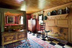 A folk-art fireboard graces an 18th-century wall in the master bedroom