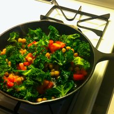 My new favorite vegan dinner - kale, chickpeas, Roma tomatoes, sautéed in olive oil with garlic. Under $2!