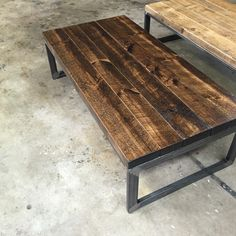 Hand made tank of a coffee table hand made in Stouffville Ontario with locally reclaimed barn board and locally welded modern steel frame.