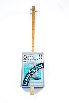 """""""Cream Crackers"""" Dulcitar. This guitar was hand made by String Tinkers. String Tinkers makes cigar box guitars, ukuleles, ducitars, canjo and fine musical instruments. www.stringtinkers.com"""