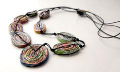 Collar de papel asimétrico by Mossona. www.facebook.com/MossonaArtPaper
