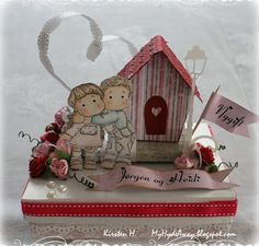 A wedding card - a decorated box of chocolate hearts.