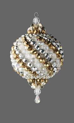 Ornament with Czech Fire-Polished Glass Beads and Silver-Plated Beads by Carol R. Davis.