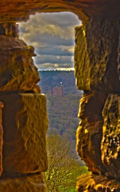 Peckforton Castle seen through one of the windows at Beeston Castle. England