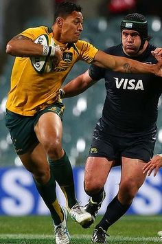 Israel Folau fends off Tomas Cubelli of Argentina during at Patersons Stadium.