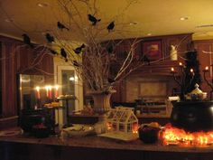 Halloween - Urn with branches and crows, tea lights and fabric to resemble fire under cauldron