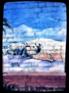 Here's a painting of some polar bears that we saw on a wall in Bromley, UK. Did you know that polar bears are classified as a vulnerable species? #polarbear #painting