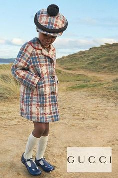 Gorgeous Gucci Girls Mini Me Beige Blue Vintage Check Wool Coat & Beret Pom Pom Hat. Designed with orange piped trims, two front pockets and a red 'Friendology' patch on one sleeve. Complete the look with a pair of blue mary jane leather shoes and matching logo socks. Shop designer girls clothes @ Childrensalon (affiliate). #gucci #guccigirl #girlscoat #childrensalon #dashinfashion Gucci Baby, Gucci Kids, Mini Me, Blue Ivy Carter, Girls Designer Clothes, Girls Special Occasion Dresses, Celebrity Kids, Gucci Fashion, Blue Check