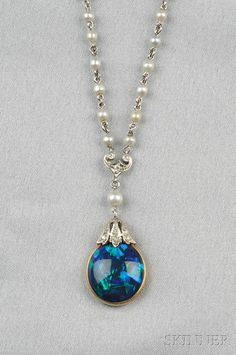 Edwardian Black Opal Pendant, bezel-set with a cabochon opal, old mine-cut diamond surmount, and suspended from platinum and pearl chain,