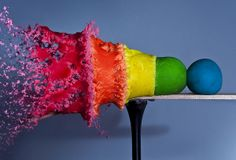 """What it looks like to shoot a line of play dough balls.  """"Artist Alan Sailer shot a bullet through five balls of Play-Doh and took a picture. The result is this amazing photograph called """"The Play-Doh Spectrum."""""""