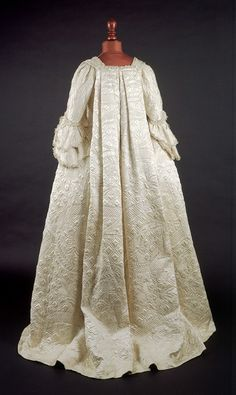 Breathtaking white silk satin open robe dress w/ sack-back (shown), matching petticoat & stomacher. It relies on wadded & corded quilting for the subtle white on white surface ornament. Lined with white silk, it must have swayed ever so gracefully about its wearer. English, c.1750-1755. @Museum of London.