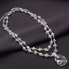 @Overstock.com - Crystale Silvertone Crystal Two-row Drop Necklace - This 16-inch crystal drop necklace brings any little black dress to elegant life. Twin strands of glittering crystal beads end in a large, shining teardrop crystal pendant, making a fiery accompaniment to any color, but especially with black.  http://www.overstock.com/Jewelry-Watches/Crystale-Silvertone-Crystal-Two-row-Drop-Necklace/5303372/product.html?CID=214117 $49.99
