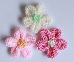 Photo tutorial for making a simple knitted flower from yarn scraps.