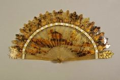 Carved horn fan, 1830s | In the Swan's Shadow