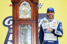 Jimmie Johnson Photos Photos - Jimmie Johnson, driver of the #48 Lowe's Chevrolet, celebrates with the trophy in Victory Lane after winning the NASCAR Sprint Cup Series Goody's Fast Relief 500 at Martinsville Speedway on October 30, 2016 in Martinsville, Virginia. - NASCAR Sprint Cup Series Goody's Fast Relief 500