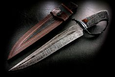 CAS Claudio Sobral D-guard Fighter Bowie Knife ladder pattern damascus steel, stag handle, blue steel guard and fittings. As usual this is a work of deadly art. Man, I love Claudios work.