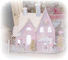 Such a cute pale pink, Shabby Chic Putz house! This would be a great addition to a collection or to a Christmas villiage.