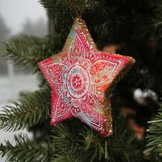 Glitter Star handmade ornament - Lightweight paper mache star ornament     decoupaged with 2 art prints front & back, then sealed  Edges are dipped in chunky gold & silver glitter. Fronts have delicate, hand-drawn line work.  #DIY #craft