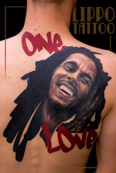 Bob Marley One Love Tattoo ... not sure i'd get a huge celebrity portrait on my back, even if it was as immaculately done as this one... amazing work, though.