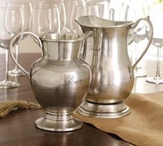 Pottery Barn antique silver pitchers.