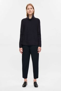 COS A-line Milano knit jumper in Navy. Black minimalist outfit | Black minimalist jumper | Black classic pants | Minimalist woman | Minimalist style | Capsule wardrobe | Intentional living | Slow fashion | Simplicity | Less is more