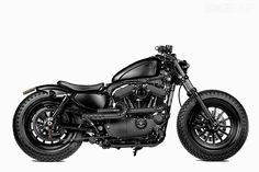 UK dealer Shaw Speed & Custom has hooked up with Taiwanese hotshop Rough Crafts to create this murdered-out Harley 48 Sportster.  This is what I would like to have. Fits me perfectly. :)