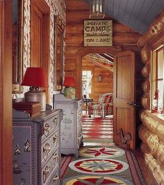 designer log cabin - Idaho timber vacation home with red, green and blue winter theme decor by Anthony Baratta - AD via Atticmag Luxury Log Cabins, Log Cabin Homes, Rustic Cabins, Cabin Design, House Design, Winter Thema, Log Home Designs, Lodge Decor, Lodge Style Decorating