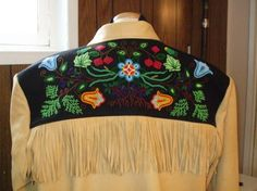 Mousetrap Custom clothiers ; beaded deerhide coat, bead design by Christi Belcourt; mostly old stock beads, Dec 2009 ; metis, Metis heritage, beadwork, beadwork people, flower beadwork people, Brionny Goddard