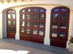 If you look closely you'll notice this is actually one sectional roll-up 2-car garage door custom-built to look like 3 arched doorways. Pretty cool huh?  See more at www.ontracdoors.com